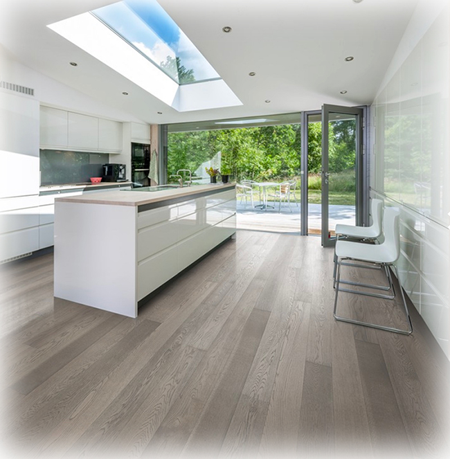 This kitchen's use of clear white oak, which minimizes the wood's pattern variations, in conjunction with a light grey tinted stain and semi-gloss sheen provides an elegant backdrop for the clean lines of this modern design plan.